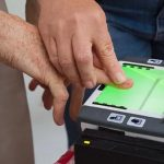 individual being fingerprinted for an arizona endangerment charge